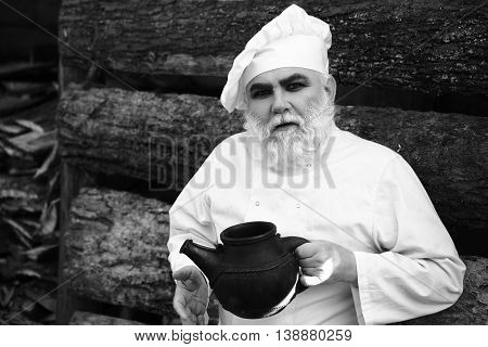 Bearded Cook With Iron Tea Kettle
