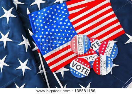 American vote badges on national flag background