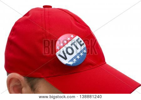 American votes concept. Voting badge pined on red cap, close up