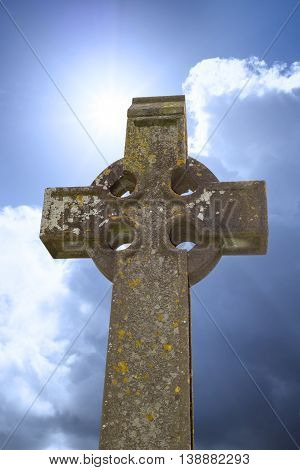 sunshine over celtic cross at ancient graveyard in St Canice's Cathedral in kilkenny city ireland