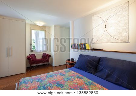 bedroom with double bed of a modern house, interior