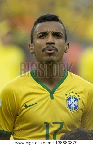 Belo Horizonte Brazil - july 08 2014: LUIZ GUSTAVO of Brazil during the FIFA 2014 World Cup. Brazil is facing Germany in the semi-finals at Mineirao Stadium