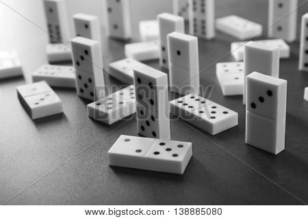 Heap of dominoes on grey background