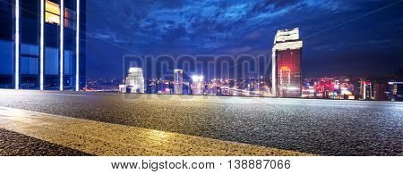modern building in downtown of chongqing at twilight on view from empty asphalt road
