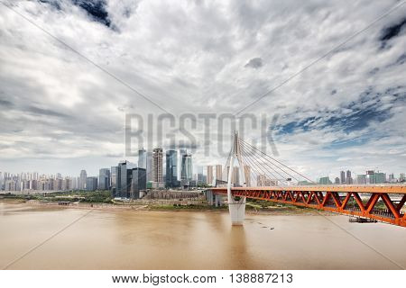 cityscape and skyline downtown near bridge of chongqing in cloud sky