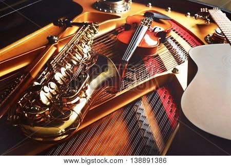 Musical instruments lying on piano, close up