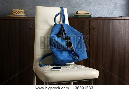 Blue jeans backpack on chair