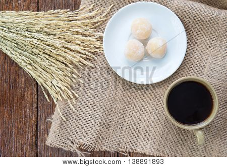Coffee and sweetmeat with rice drying on Sackcloth brown.Top view focus.