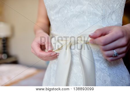 Beautiful White Wedding Dress For Bride Indoors. Beauty Of Bridal Gown For Marriage. Female Lace Clo