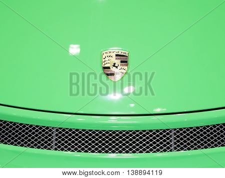 Bangkok - March 22 : logo of Porsche on green bonnet super sport car- in display at The 37th Bangkok international Motor Show 2016 on March 22 2016 in Bangkok Thailand