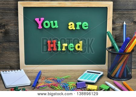 You are hired word on school board