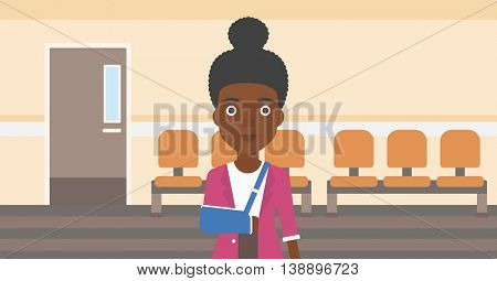 An african-american young woman with broken right arm in brace standing in the hospital corridor. Vector flat design illustration. Horizontal layout.