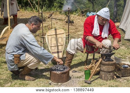 Blacksmith Working Outdoors