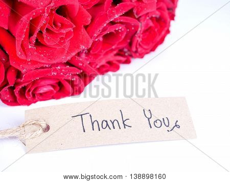 Bouquet red roses flower and handwriting word Thank you on isolated / white background