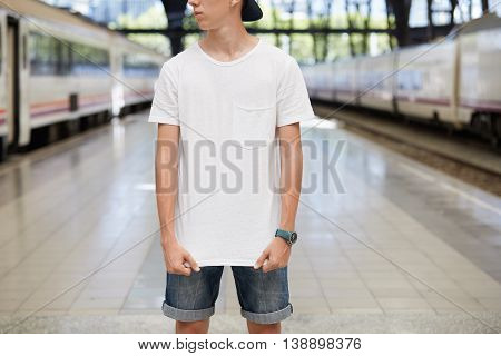 Cropped Portrait Of Teenage Boy Wearing Denim Shorts And Blank White T-shirt With Copy Space For You