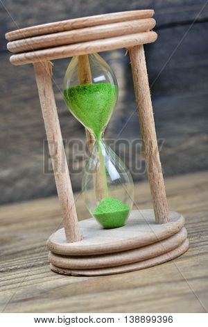 Hourglass on wooden table