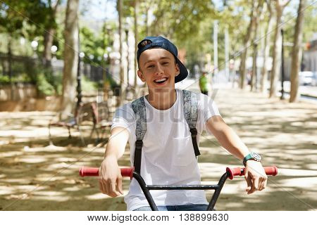 Youth And Happiness Concept. Young Bmx Rider Hanging Out In A Suburban Setting. Happy Smiling High S