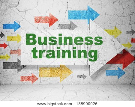 Education concept:  arrow with Business Training on grunge textured concrete wall background, 3D rendering