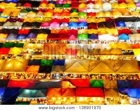 High view of colorful tent retail shop with night light at Talad Rod Fai Night Market Ratchada Bangkok Thailand