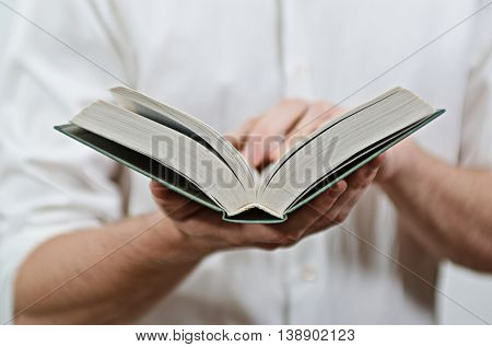 Young Adult Man's Hands Close-Up, Reading a Book
