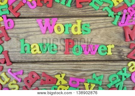 Words have power text on wooden table