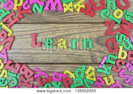 Learn word on wooden table