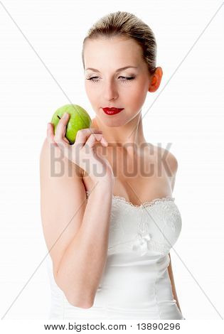 Beautiful woman looks at an apple