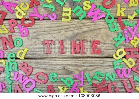 Time word on wooden table