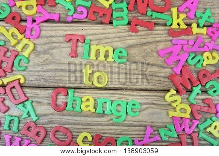 Time to change word on wooden table