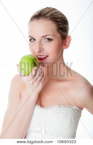 Sexy woman eats an apple