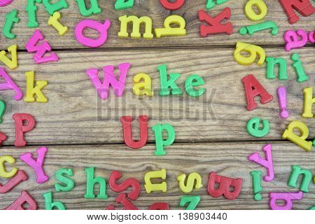 Wake up word on wooden table