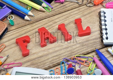 Fail word and office tools on wooden table