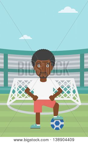 An african-american sportsman standing with football ball on the football stadium. Professional football player with a soccer ball on the field. Vector flat design illustration. Vertical layout.