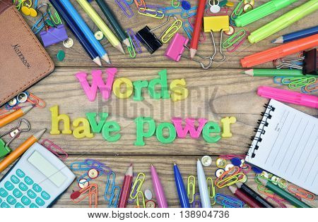 Words have power word and office tools on wooden table