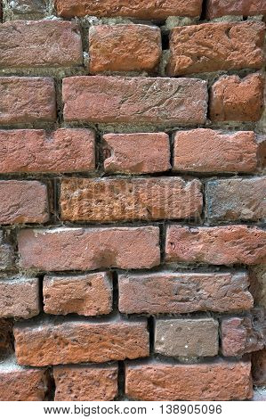 Hand made brick wall of four hundred years old church wall.