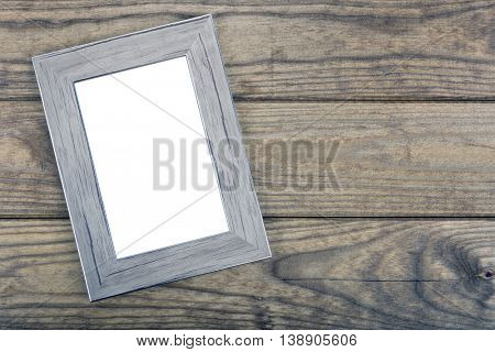 Empty photo frame on wooden table