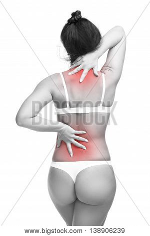Young caucasian woman in underwear with backache neck pain in the female body isolated on white background with red dot copy space