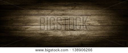 panoramic black and white grunge background of old wooden boards with vignette