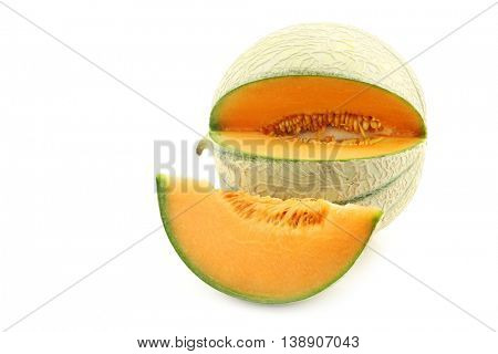 fresh cantaloupe melon and a cut oiece on a white background