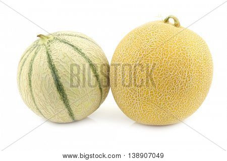 fresh galia melon and a cantaloupe melon on a white background