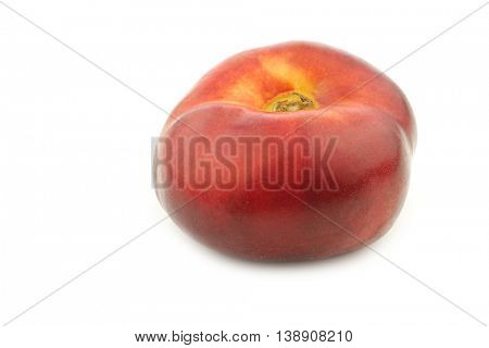 fresh and juicy wild flat nectarine on a white background