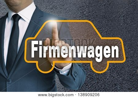 Firmenwagen (in German Company Car) Auto Touchscreen Is Operated By Businessman Concept