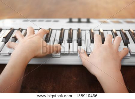 Man playing on synthesizer closeup