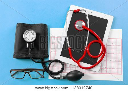 Medical concept. Medical manometer and a stethoscope on color background