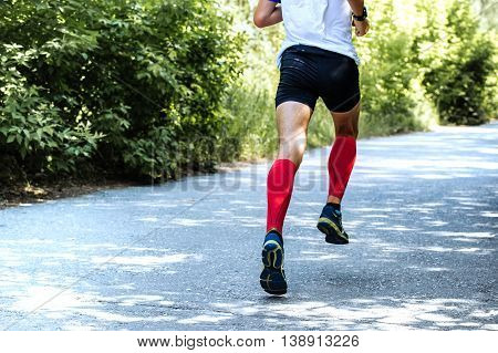 back view of running young male athlete during marathon