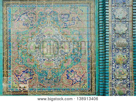 KERMANSHAH, IRAN - OCT 12, 2014: Old tiles with traditional Persian patterns on historical mosque on October 12, 2014. With population of 855000, Kermanshah developed in the 4th century AD by Sassanian kings