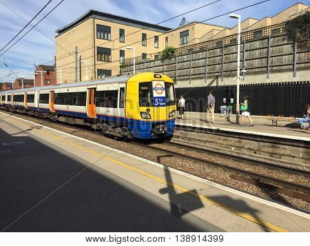 LONDON - JULY 18: A London Overground Train pulls into the Eastbound platform at Finchley Road & Frognal Station on the morning of July 18, 2016 in North London, UK.