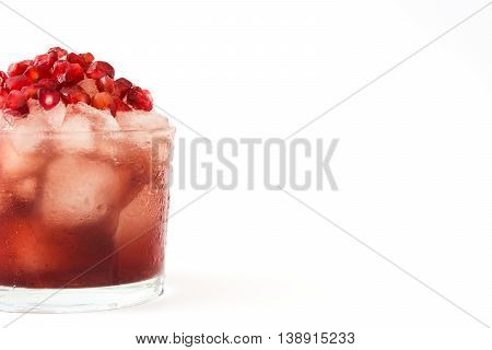 Red cocktail with pomegranate and ice isolated on white background