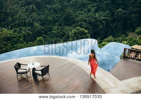 Woman At Luxury Resort Poolside
