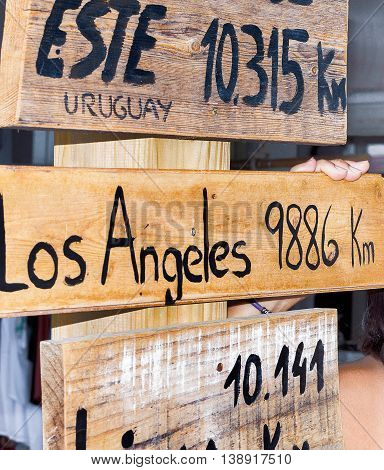 Los Angeles wooden signpost, sign pointing to various cities and directions
